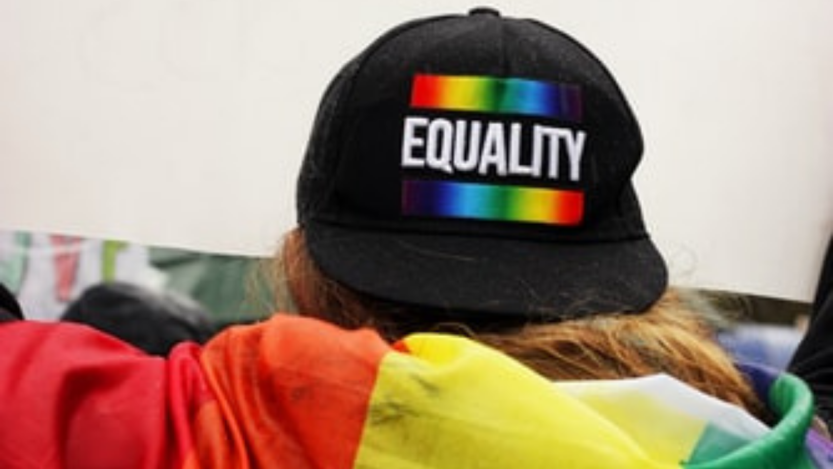 Back of a black hat with the word Equality in white bold text and rainbow stripe above and below
